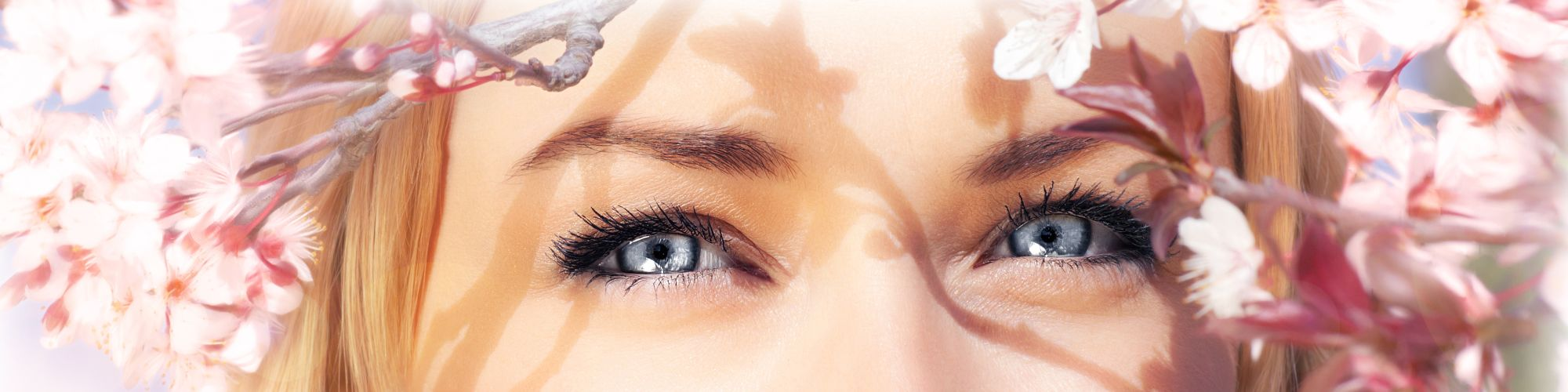 woman eyes pink flowers